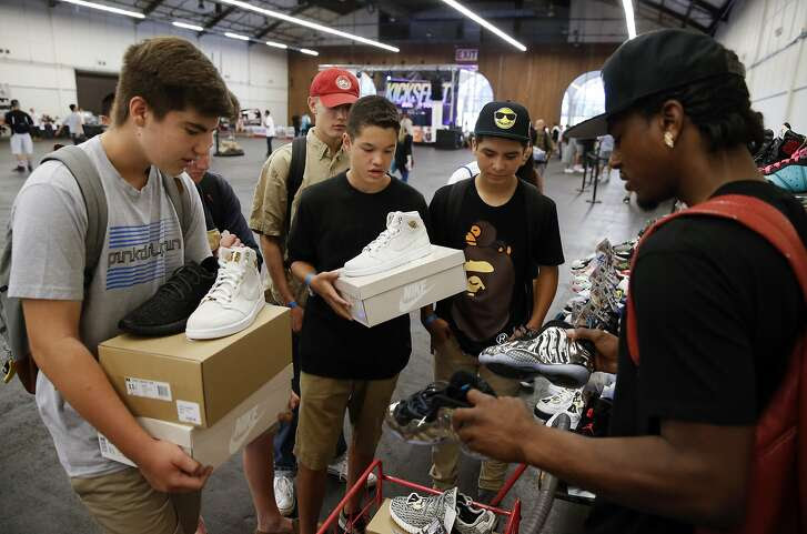 Collector Don C. of San Francisco, (right) negotiates a trade with Dominic Susa, 15 (left) and James Houston,15 (center), both from Belmont, during the San Francisco Kickfest  event, a buying, selling or trading of athletic footwear event at the San Mateo County Expo Center on Sat. August 29, 2015, in San Mateo, Calif.