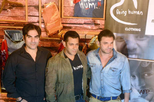 Salman Khan (C) poses with siblings Arbaaz Khan (L) and Sohail Khan during the launch of his 'Being Human' flagship clothing store in Mumbai on January 17, 2013. (AFP)
