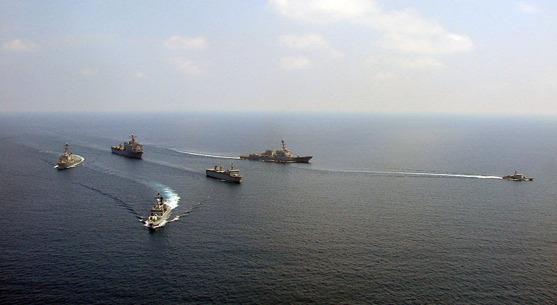 The Royal Malaysian Navy multi-role support ship KD Sri Indera Sakti, corvette KD Lekir and patrol vessel KD Handalan maneuver in formation with the amphibious dock landing ship USS Harpers Ferry (LSD 49) and the guided-missile destroyers USS Chafee (DDG 90) and USS Chung-Hoon (DDG 93) during a training  exercise in the South China Sea, 2009.