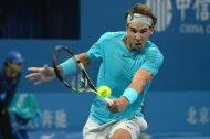 Rafael Nadal of Spain hits a return during his men's singles final match against Novak Djokovic of Serbia in Beijing on October 6, 2013