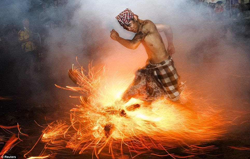 A Balinese man kicks up fire during the Perang Api (Fire War) ritual ahead of Nyepi day, in Gianyar on the Indonesian island of Bali, March 11. Nyepi is a day of silence for self-reflection to celebrate new year