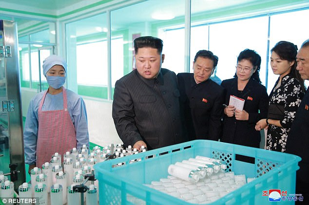 Kim was visiting the production plant in Pyongyang with his secretive partner, Ri Sol-ju, and called on women in his country to be 'more beautiful'