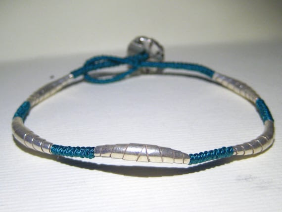 thin knotted bracelet, with five Karen silver origami elements