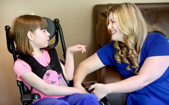 Amelia Weaver and her mother Angie share a connection during a conversation at their home in Hibbing, Minn., recently. Amelia's condition has improved since she began using medical marijuana to treat a form of epilepsy. (Bob King / rking@duluthnews.com)