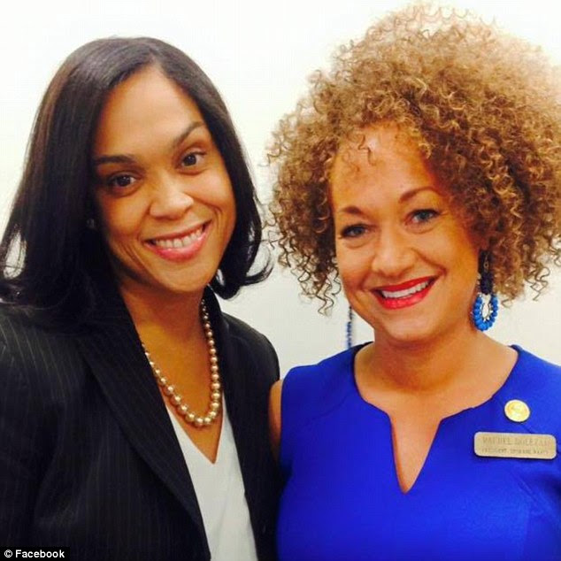 Highly visible activist: Dolezal has been a highly visible civil rights activist in the Eastern Washington/Idaho region for years. She's seen here with Baltimore State's Attorney Marilyn Mosby