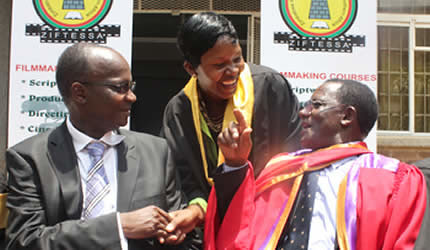 Zimbabwe Information Minister Jonathan Moyo with Film and Television School of Southern Africa director Dr Rino Zhuwarara congratulating photographer Ruvimbo Chakanyuka in Harare on October 26, 2013. by Pan-African News Wire File Photos