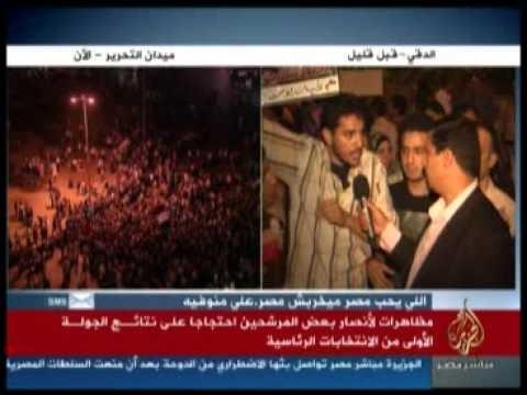 بالفيديو : الجزيرة / أنصار شفيق يتّهمون الإسلاميين واليساريين والنّاصريين بحرق مقرّ شفيق