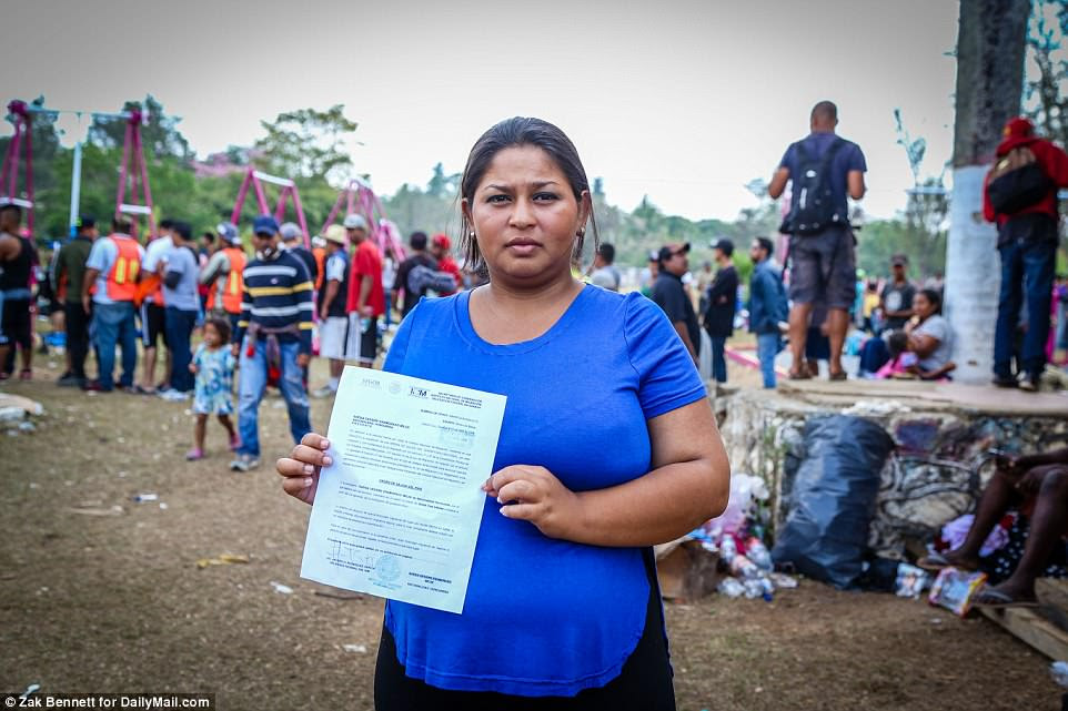 Elsy Mejia, 25, who will give birth in roughly 10 days holds her 20 travel document to travel within Mexico. She is currently waiting at Ferrocarrilero Viøctor F Morales Sports Center