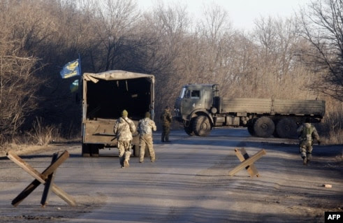 Pro-Russian rebels hand off bodies of Ukrainian soldiers killed in Debaltseve at a checkpoint near Horlivka on February 24.