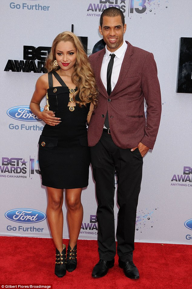 Young love: Vampire Diaries actress Kat Graham and fance Cottrell Guidry looked like the picture-perfect image of love