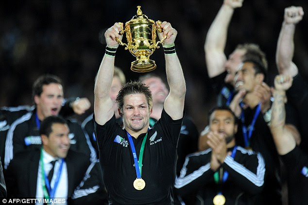 At long last: New Zealand captain Richie McCaw holds aloft the Webb Ellis cup after his side beat France