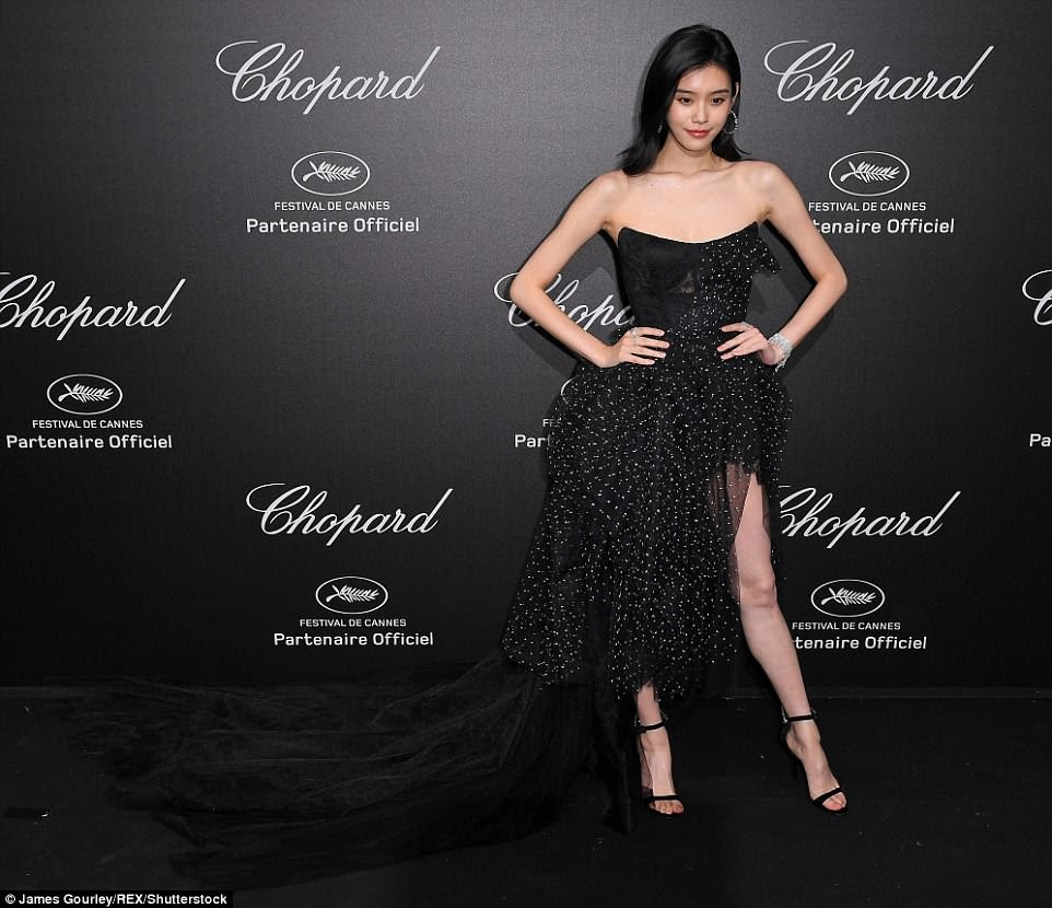 What a dress!Ming Xi wowed in her thigh-split dress that featured a long train of fabric to capture the eyes and attention of all the party-goers at the Chopard bash