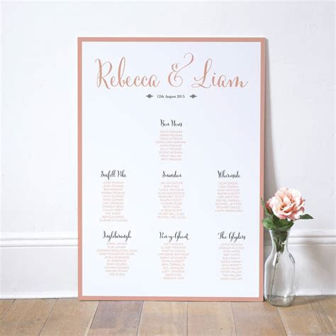 calligraphy script wedding table plan by russet and gray