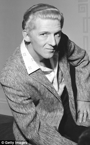 Jerry Lee Lewis (pictured in 1962) saw top ten hits including Great Balls of Fire, Whole Lot of Shakin' Going On and Breathless over his career