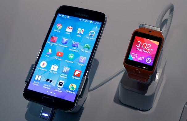 A Samsung Galaxy S5 smartphone, left,  and a Samsung Gear 2 are displayed at the Samsung Galaxy Studio, in New York,  Monday, Feb. 24, 2014. Samsung on Monday unveiled a new smartphone with a built-in heart rate monitor to complement three upcoming fitness devices, as the Korean company tries to turn its technological wizardry into lifestyle products. (AP Photo/Richard Drew)