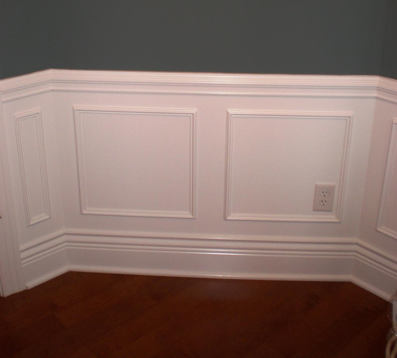 large chair rail molds in white with an electric port hardwood floors