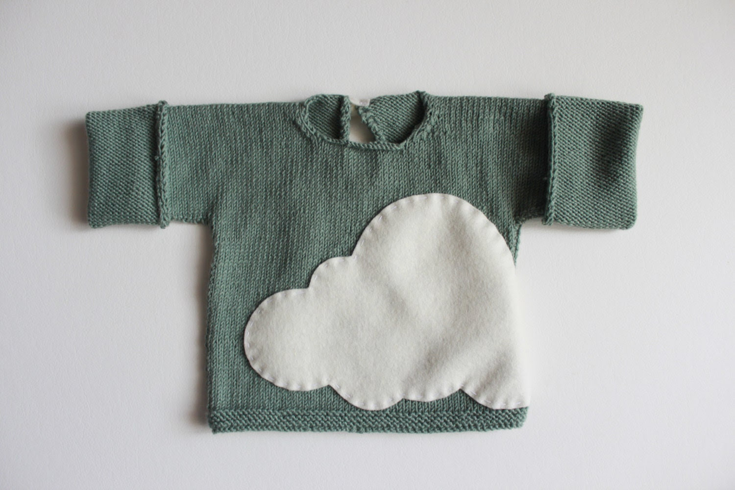 Handknitted baby sweater in 100% baby merino in green mint, with a lovely cloud.  Special newborn gift