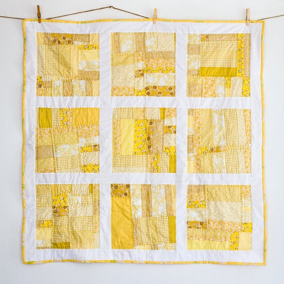 Scrappy yellow quilt- would be cute if each square was a different colour
