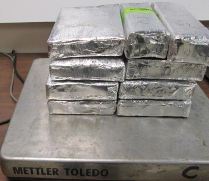 Bundles on a scale totaling 20.76 pounds of cocaine seized by CBP officers at Hidalgo/Pharr/Anzalduas Port of Entry