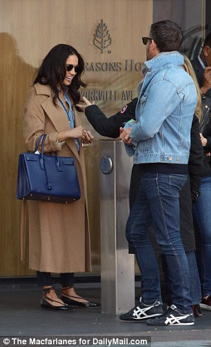 Meghan and Markus laughed outside the Four Seasons following lunch