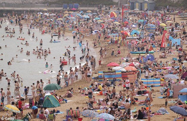 Flashback: Sunseekers pack a beach in Broadstairs, Kent, two weeks ago as temperatures hit 29c