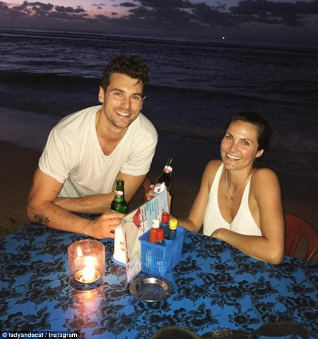 'Find me a happier girl': On Tuesday, the pair were seen enjoying a romantic candelit dinner on Bali's Bingin Beach