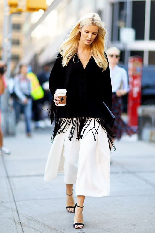 Le Fashion Blog Street Style Kate Davidson Hudson Black Fringed Cape Top White Wide Leg Culottes Ankle Strap Heeled Sandals Via Popsugar