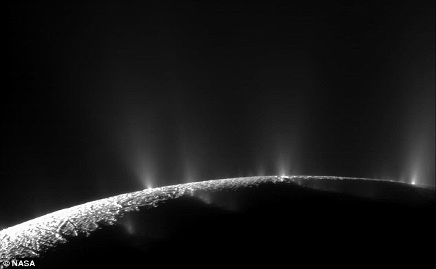 The team found that a geothermal process thought to occur at Enceladus's core may generate enough hydrogen gas to support methanogenic microbes. Pictured is an image taken by Nasa probe Cassini of hydrothermal vents on Enceladus firing water from its subsurface ocean