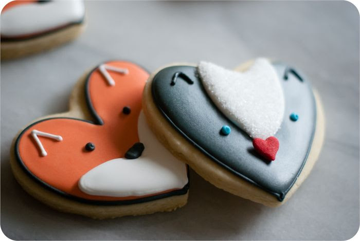 fox and skunk cookies from a heart cookie cutter, simple cookie decorating tutorials