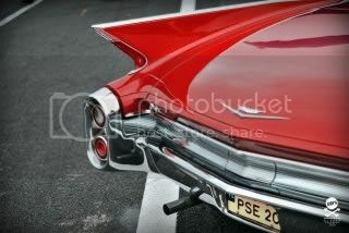red 1959 cadillac deville fins