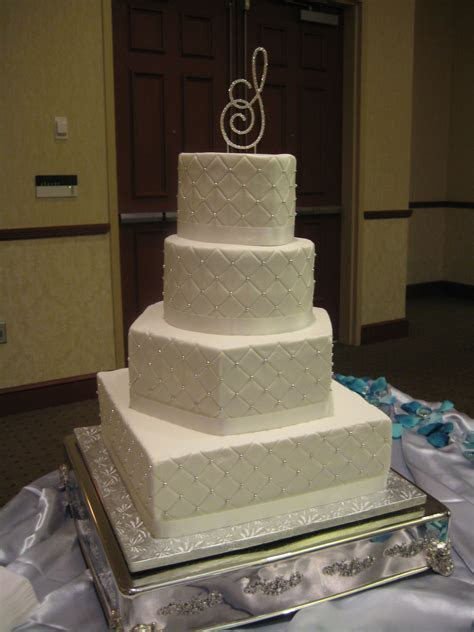 4 tier mixed shape wedding cake. Includes heart, round