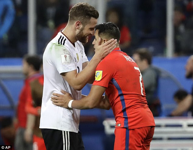 Germany's Shkodran Mustafi, left, hugs his Arsenal team-mate following the final whistle