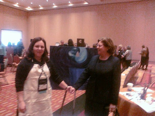 Regina Holliday hands with Maureen Bisognano, President and CEO, Institute for Healthcare Improvement