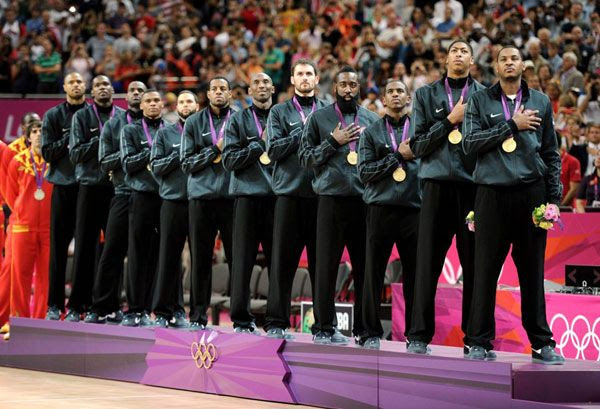 The U.S. men's basketball team celebrates with gold medals after defeating Spain, 107-100, on August 12, 2012.
