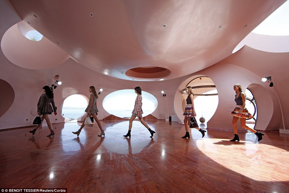 Models present creations by Belgian designer Raf Simons for Dior's women Cruise 2016 collection during a fashion show at the Palais Bulles