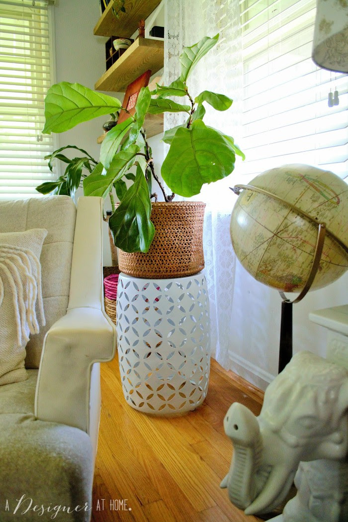 garden stool with a woven basket planter looks so cute together!