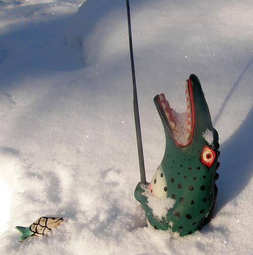 Reptilian ice fisherman