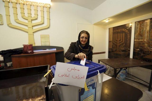 Quelque 55 millions d'Iraniens sont appelés à se... (Photo Atta Kenare, Agence France-Presse)