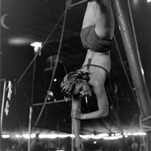mydarling:  Circus girl smokes while rehearsing her stunts.  Nina Leen, 1949.