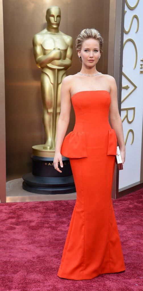 Jennifer Lawrence wearing a Dior gown, 100 carats worth of Neil Lane diamonds and a Ferragamo clutch at the 2014 Oscars.