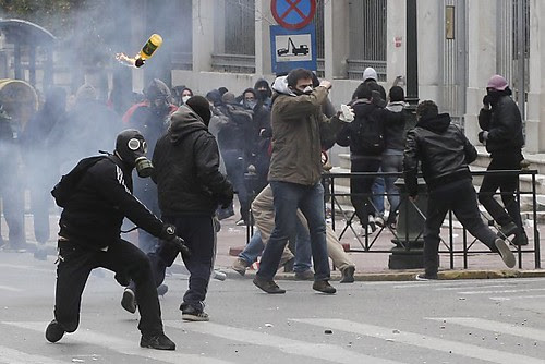 Greek protesters battle riot police in Athens during a general strike over the imposition of austerity measures inside the country. The capitalist economic crisis has hit the country hard. by Pan-African News Wire File Photos