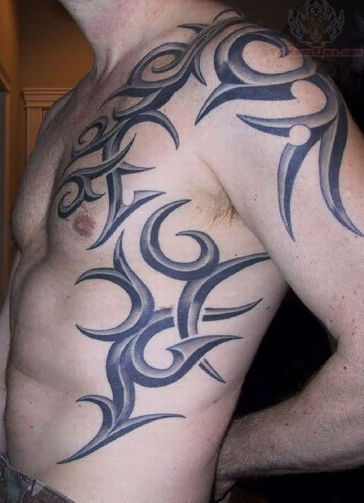 Tribal Tattoo On Shoulder And Chest And Hip