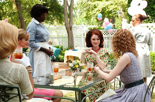"""THE HELP""..946_D_03188..Aibileen Clark (Viola Davis, standing) attends to the needs of Hilly Holbrook (Bryce Dallas Howard, seated center) and her friends Elizabeth Leefolt (Ahna O'Reilly, left) and Skeeter Phelan (Emma Stone, right) in DreamWorks Picture by emrahozcan"