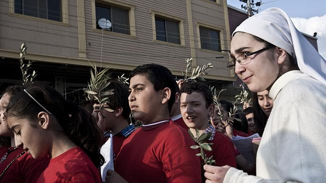 Christians celebrate Palm Sunday in the streets of Ankawa.