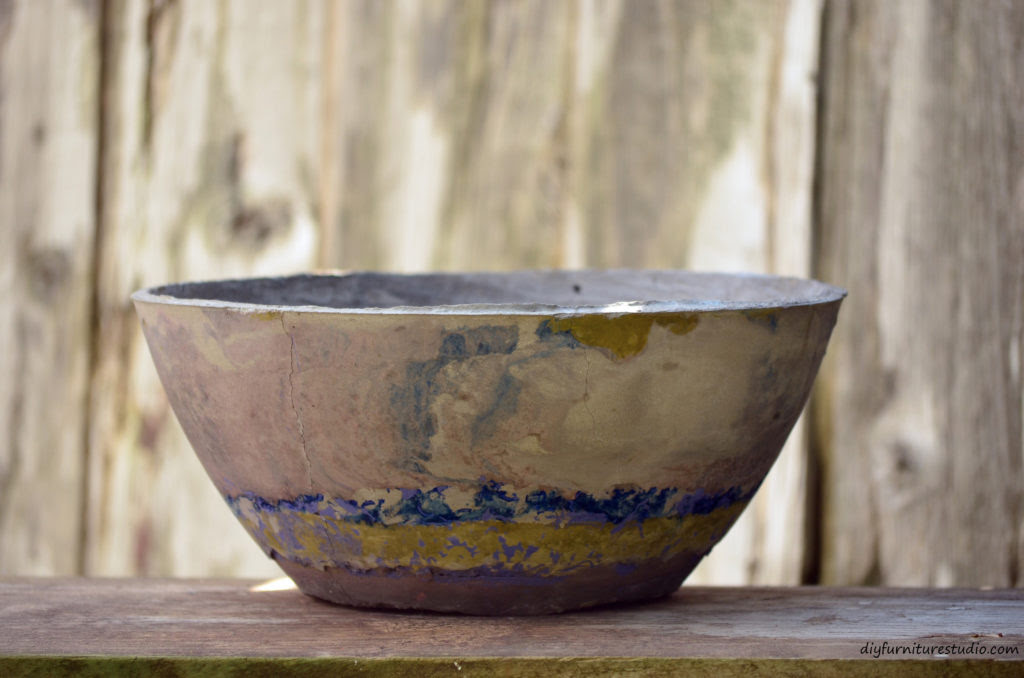 Large DIY cement bowl tinted with latex paint.