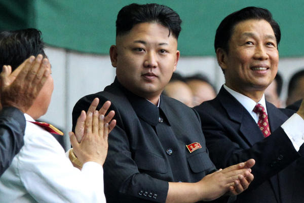 """North Korean leader Kim Jong Un, center, arrives at the """"Arirang"""" mass games song-and-dance ensemble on the eve of the 60th anniversary of the Korean War armistice in Pyongyang, North Korea."""