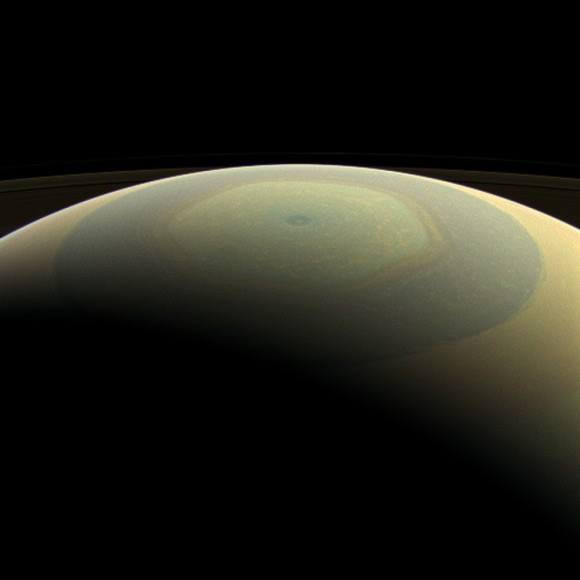 Saturn makes a beautifully striped ornament in this natural-color image, showing its north polar hexagon and central vortex (Credit: NASA/JPL-Caltech/Space Science Institute)