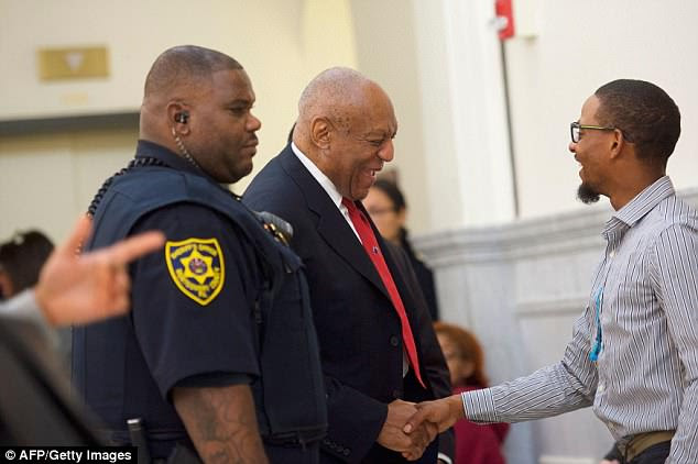 Cosby greets a man inside Montgomery County Courthouse on Thursday before jury deliberations started