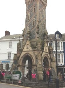 Machynlleth town clock decorated with pink ribbons