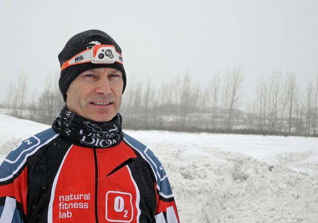 Gilles Parisien, race organizer for this Saturday's Dion Ignite the Night snowshoe race at Upper Canada Village, is ecstatic with the number of registrants for the inaugural event. Competitors will need to be wearing a head lamp (such as the one worn here by Parisien), for while the race starts under the bright lights of the Alight at Night display at UCV, much of the course is in the dark. Kevin Gould/Cornwall Standard-Freeholder/QMI Agency